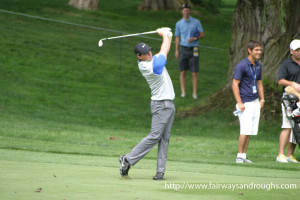 Rory McIlroy taking a swing on the fairway